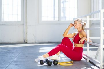 A girl working out with a resistance band tricep exercise.