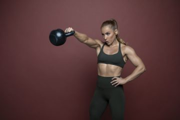 A girl working out with a kettlebell.